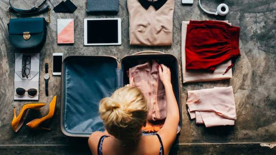 Put-in-Bay-Vacation - A photo of a girl packing her suitcase for a vacation to the Put-in-Bay islands.