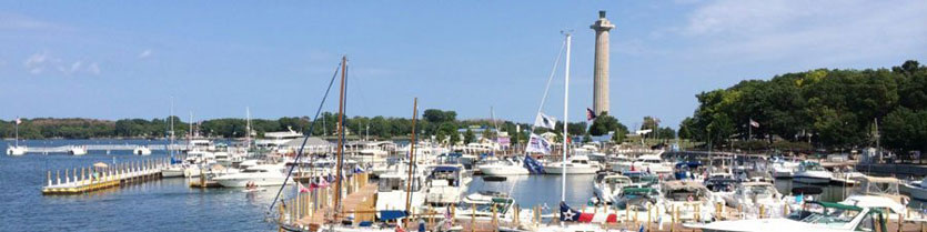 Put-in-Bay Ohio - A waterfront view of the Put-in-Bay marina with the Perry's Victory & International Peace Memorial in the background.