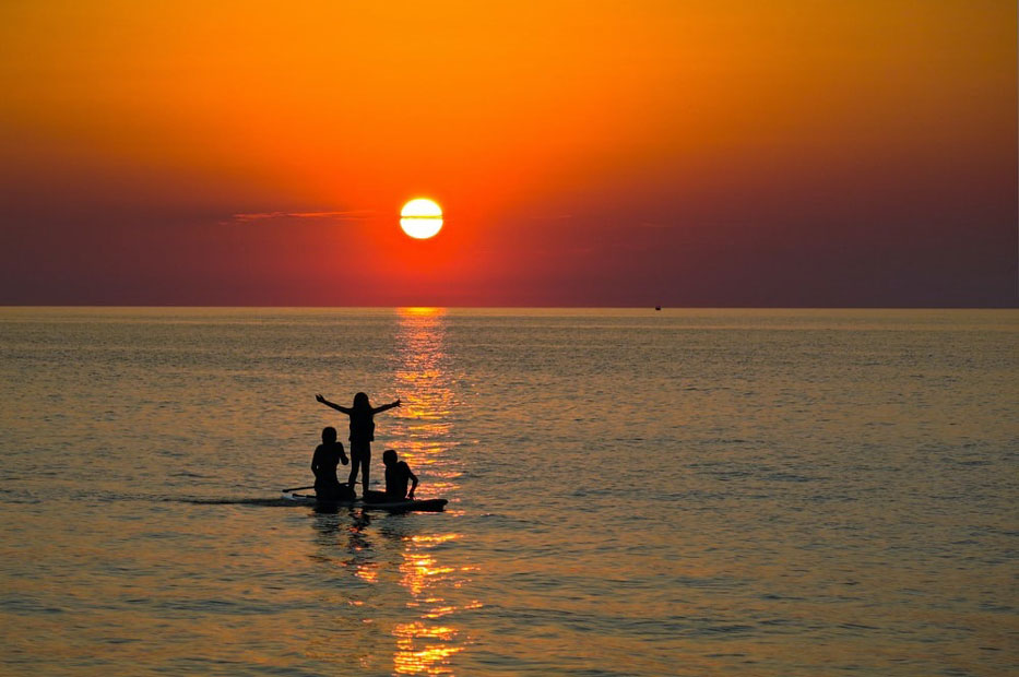 Lake Erie - Photo of a Lake Erie sunset with three kids on a kayak.